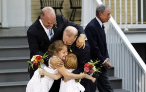 Jonathan Mintz and John Feinblatt, embracing their daughters Maeve and Georgia, in celebration of their marriage.  - photo: Reuters
